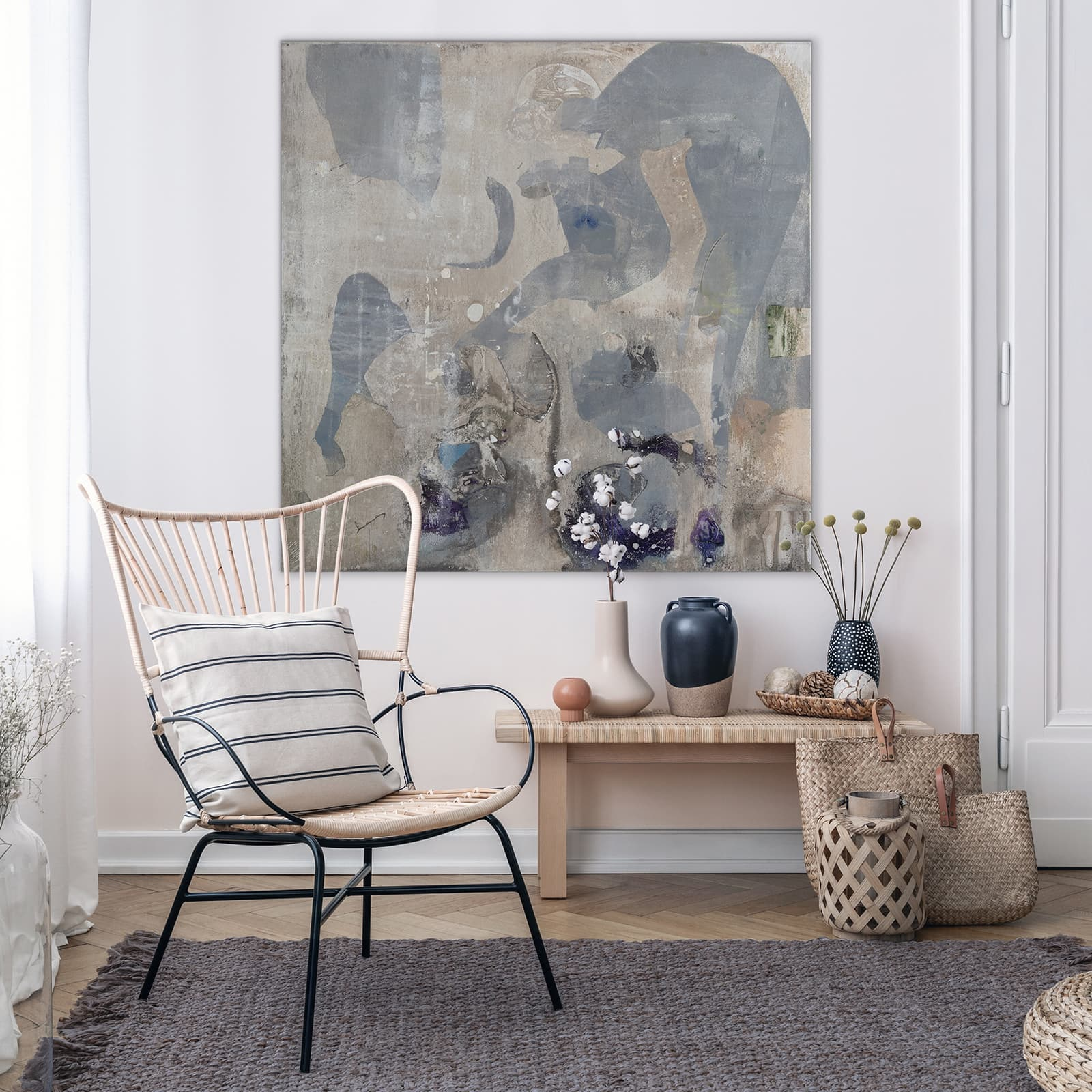 Flowers On Wooden Stool Next To Armchair In White Loft Interior